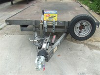 indespension-twin-axle-flat-plantcar-trailer